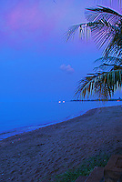Nighttime view of the lovely Lovina beach with the headland in the distance.