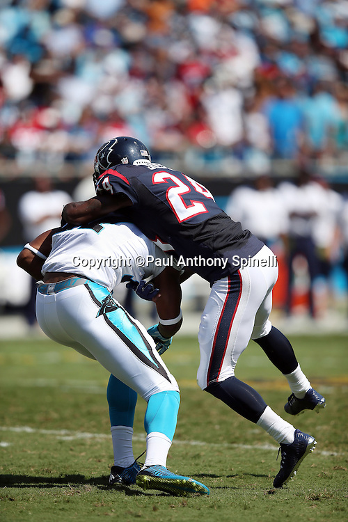 Carolina Panthers wide receiver Devin Funchess (17) gets tackled by Houston Texans cornerback Johnathan Joseph (24) after catching a pass for a second quarter first down during the 2015 NFL week 2 regular season football game against the Houston Texans on Sunday, Sept. 20, 2015 in Charlotte, N.C. The Panthers won the game 24-17. (©Paul Anthony Spinelli)