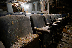 View on a row of chairs in the auditorium of the Uptown Theatre as visitors had the chance to tour the dilapidated structure during this year's Philly Free Streets, on Saturday. (Bastiaan Slabbers for WHYY)