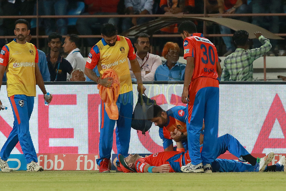 Andrew Tye of GL injured during match 35 of the Vivo 2017 Indian Premier League between the Gujarat Lions and the Mumbai Indians  held at the Saurashtra Cricket Association Stadium in Rajkot, India on the 29th April 2017<br /> <br /> Photo by Rahul Gulati - Sportzpics - IPL