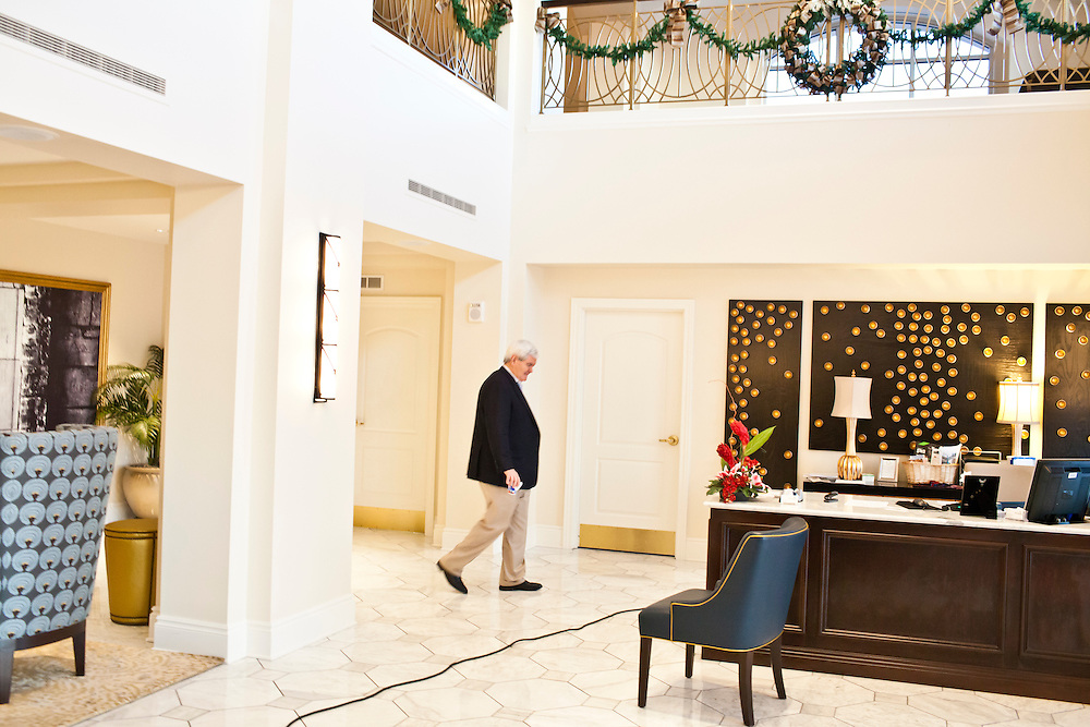Republican presidential candidate Newt Gingrich walks away after a series of television interviews at the Hotel Blackhawk on Tuesday, January 3, 2012 in Davenport, IA.