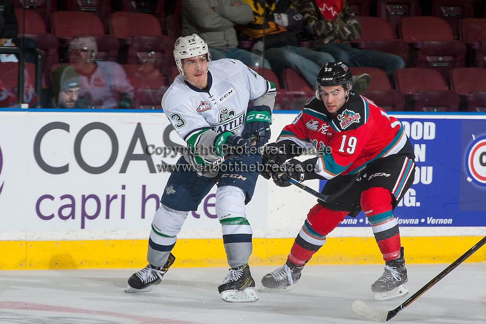 KELOWNA, CANADA - DECEMBER 7: Dillon Dube #19 of the Kelowna Rockets checks Mathew Barzal #13 of the Seattle Thunderbirds on December 7, 2016 at Prospera Place in Kelowna, British Columbia, Canada.  (Photo by Marissa Baecker/Shoot the Breeze)  *** Local Caption ***