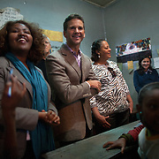 US representatives Aaron Schock, IL, and Laura Richardson, CA, meet with girls attending Biruh Tesfa in Addis Ababa, during their CARE Learning Tour to Ethiopia. Biruh Tesfa means bright future in Amharic, and is a program for urban adolescent girls at risk of exploitation and abuse. For many girls, going to Biruh Tesfa is their only hope of an education and a respite from their domestic work. ..The program promotes functional literacy, life skills, livelihoods skills, and HIV/reproductive health education through girls' clubs led by adult female mentors. The girls' clubs are held in meeting spaces donated by the kebele (local administration).