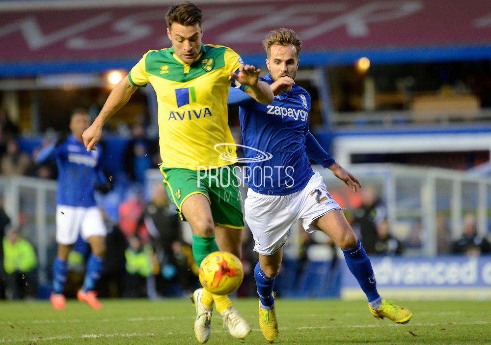 Russell Martin and Andy Shinnie tussle during the Sky Bet Championship match between Birmingham City and Norwich City at St Andrews, Birmingham, England on 31 January 2015. Photo by Alan Franklin.