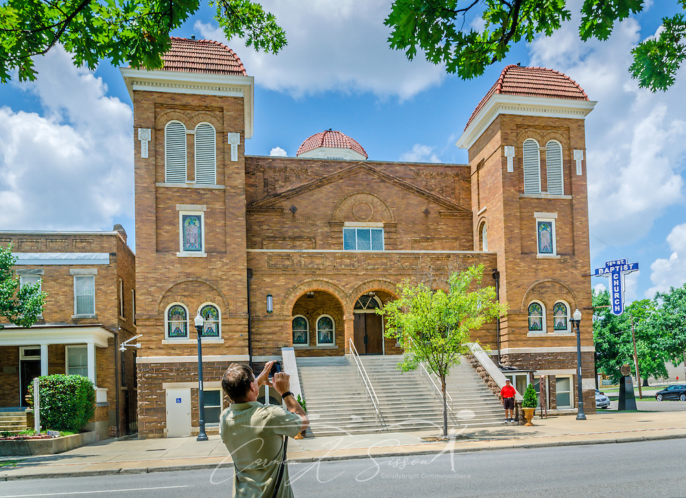 A tourist takes a photograph of 16th St. Baptist Church, July 12, 2015, in Birmingham, Alabama. The historic African-American church took a central role in the Civil Rights movement when it was bombed by members of the Ku Klux Klan on Sept. 15, 1963. Four little girls were killed in the bombing. (Photo by Carmen K. Sisson/Cloudybright)