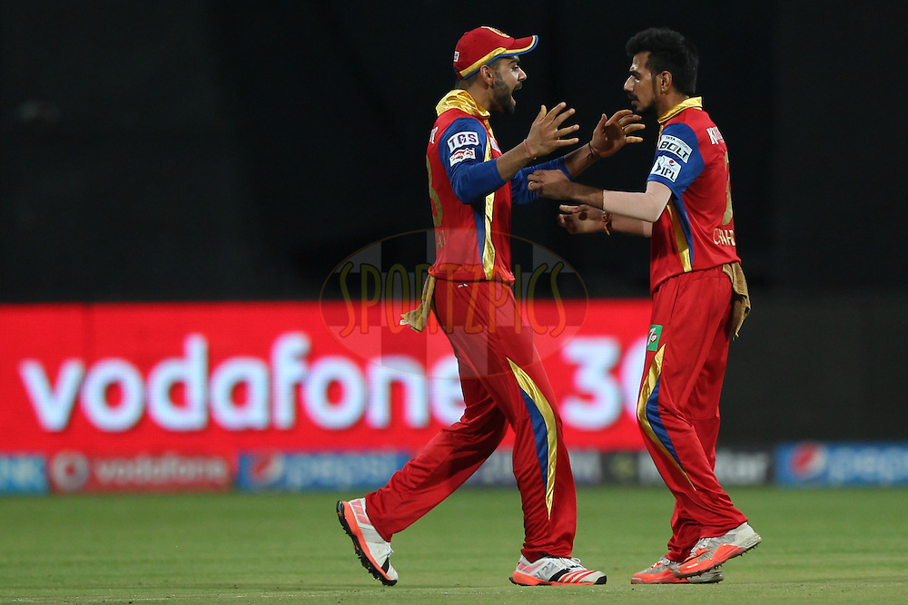 Virat Kohli , Yuzvendra Chahal of the Royal Challengers Bangalore celebrates the wicket of MS Dhoni captain of The Chennai Superkings  during match 20 of the Pepsi IPL 2015 (Indian Premier League) between The Royal Challengers Bangalore and The Chennai Superkings held at the M. Chinnaswamy Stadium in Bengaluru, India on the 22nd April 2015.<br /> <br /> Photo by:  Deepak Malik / SPORTZPICS / IPL