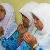 Malaysian Muslim women pray during the 'berendoi' ceremony in Kuala Lumpur, Malaysia. Berendoi is part of malay tradition in welcoming newborn baby.