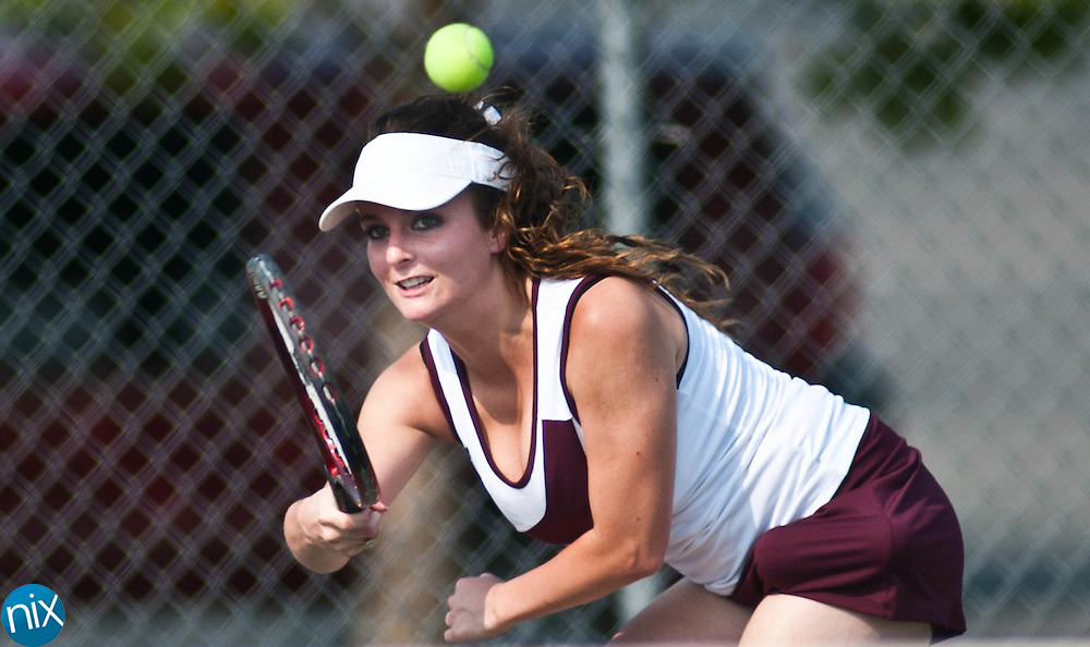 Jay M. Robinson's Rose Hall returns a shot during a match against Northwest Cabarrus' Sydney Rowland Monday afternoon in Concord. (Photo by James Nix)