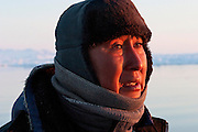 Emil Madsen is on the hunt for a seal just after midnight in Scoresby Sound, the enormous fjord on Greenland's eastern side.  (Emil Madsen is featured in the book What I Eat: Around the World in 80 Diets.)  Later tonight he will shoot that seal and bring it back home for his wife, Erika, to clean and cook. MODEL RELEASED.