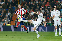 Real Madrid´s Daniel Carvajal (C) and Atletico de Madrid´s Griezmann during Spanish King´s Cup match at Santiago Bernabeu stadium in Madrid, Spain. January 15, 2015. (ALTERPHOTOS/Victor Blanco)