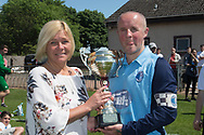 Ann Kelly presents the Sean Kelly Memorial Cup to Riverside CSC captain Paul Cooney - Riverside CSC (light blue) v Hilltown Hotspurs (green) in the Dundee Saturday Morning Football League Shaun Kelly Memorial Cup Final at North end, Dundee, Photo: David Young<br /> <br />  - &copy; David Young - www.davidyoungphoto.co.uk - email: davidyoungphoto@gmail.com