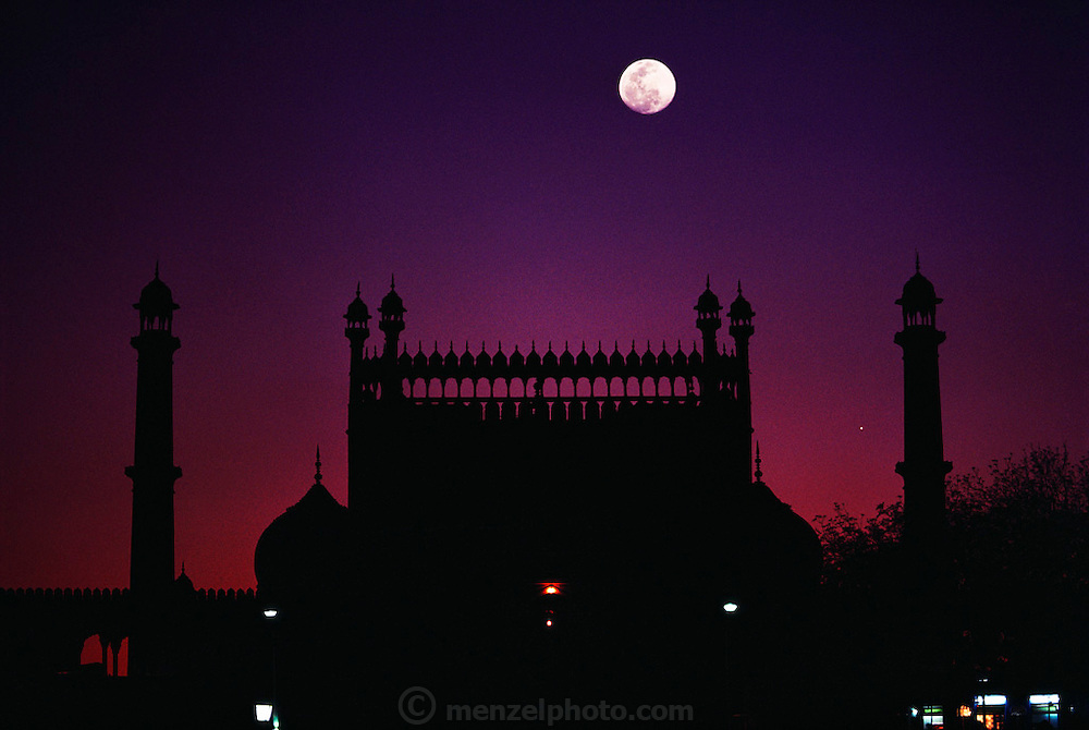 Jama Masjid Mosque, the largest in India,  at dusk with full moon. New Delhi, India.