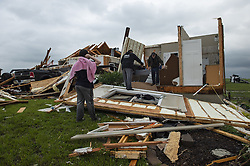 May 29, 2019 - USA - Jacob Boatwright, 14, left, watches while friends and neighbors helped clear items from his home west of Bonner Springs, Kansas after it was hit by a tornado Tuesday night, May 29, 2019. Jacob rode out the storm with his parents Travis and Kay Boatwright in the basement of the home and had to crawl out on their hands and knees. They escaped unharmed. (Credit Image: © TNS via ZUMA Wire)