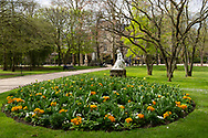 Spring flowers around a statue in the Luxembourg Garden. Paris, France, Europe