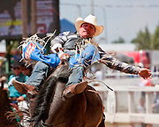 Clint Knutson of Gillette, Wyoming, shows great form during the Bareback competition at the 2009 Cheyenne Frontier Days.