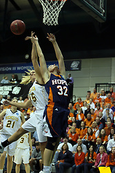 19 March 2010: Kate Agan tips the ball away from Erika Bruinsma.The Flying Dutch of Hope College defeat the Yellowjackets of the University of Rochester in the semi-final round of the Division 3 Women's Basketball Championship by a score of 86-75 at the Shirk Center at Illinois Wesleyan in Bloomington Illinois.