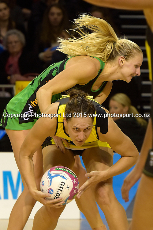 Fever's April Letton (Top) fights for possession with Pulse's Jodi Brown during the ANZ Championship - Pulse v Fever netball match at the TSB Arena in Wellington on Monday the 19th of April 2015. Photo by Marty Melville / www.Photosport.co.nz