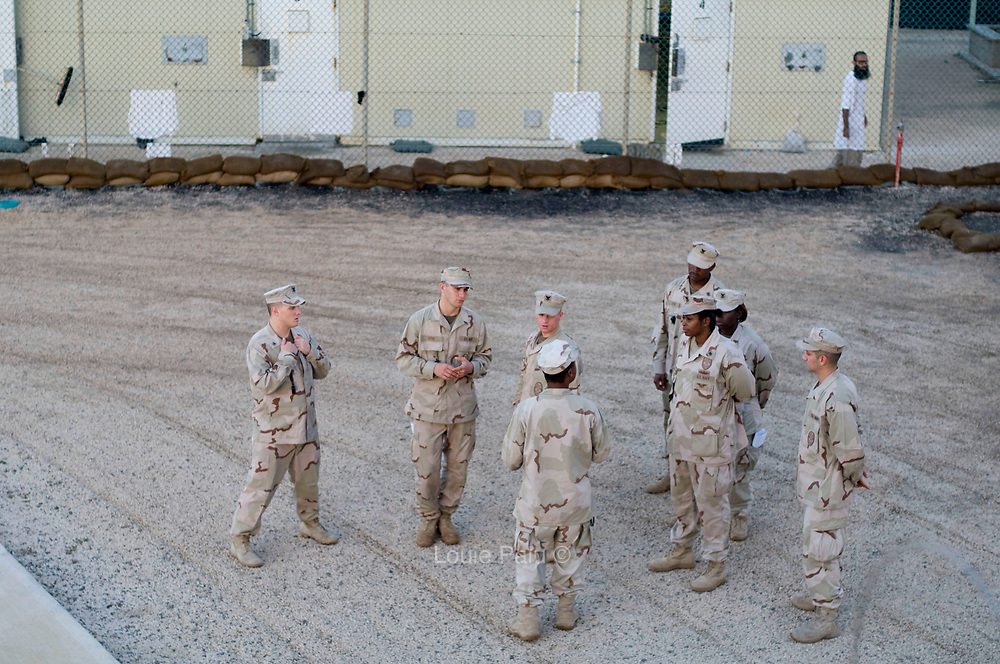 Camp guards have a morning meeting in the main yard in Camp 4 at the Guantanamo Bay Detention Facility located on the US Naval Station in Guantanamo Bay, Cuba. (Credit Image: © Louie Palu/ZUMA Press)