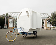 Rotation, rotation, rotation: The house built on a TRICYCLE for those who can't afford their own place<br /> <br /> As the populations of the world's major cities continue to grow, accommodation will become an increasingly sought-after commodity.<br /> Now designers in China, which itself has more than one billion inhabitants, have have come up with a potential solution.<br /> It's a mobile home called the Tricycle House that has been created for people who cannot afford their own home. It is equipped with an integrated water tank, bath tub and a stove.<br /> The bed transforms into a dining table or a bench to make the interior versatile and suitable for any occasions.<br /> Modular design allows for expansion and interconnection between units.<br /> <br /> The until itself is made of translucent plastic which lets in natural light during the day and the glow from street lamps at night.<br /> The house is fitted onto the frame of a tricycle and so can be taken just about anywhere.<br /> It has been created by the People's Industrial Design and People's Architecture Office based in the Chinese capital of Beijing.<br /> The Tricycle House was made for the 2012 Get It Louder Exhibition in Beijing.<br /> A spokesman explained: 'Private ownership of land in China does not exist.<br /> 'The Tricycle House suggests a future embrace of the temporary relationship between people and the land they occupy.<br /> 'In a crowded Chinese city single family homes can be affordable and sustainable, parking lots are used at night, and traffic jams are acceptable.<br /> <br /> 'As a construction method we experimented with folded plastic. Each piece of the house is cut with a CNC router, scored, folded and welded into shape.<br /> 'The plastic, polypropylene, can be folded without losing its strength.<br /> 'Therefore the house can open up to the outside, expand like an accordion for more space, and connect to other houses.<br /> 'The plastic is translucent allowing the interior to be lit by the sun during the day or street lamps at night.<br /> 'The Tricycle House is man-powered and operates off-the-g