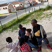 Home from Home is an organisation which provides homes for children. The children are all vulnerable, some orphans or from broken homes,some living with HIV/AIDS and from the local community.  The homes only have up to 6 children, there will be one woman running the house as a mother would, 24 hours providing the children with a sense of family. Here counsellor Charlotte McLea visits one of the homes and chat to the children. Charlotte McLea does weekly weekly visits to all families to make sure every thing is going well and many of the children bond with her closely.