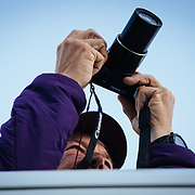 Teten Science Schools tour participants watch a herd of elk forage in the early morning hours. (Greg Peck)
