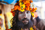 Portrait of a Naga Sadhu with garland during the  Hindu Festival of Maha Kumbh Mela Haridwar, Uttarakhand, India