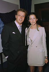 MISS SASHA COOKE and MR JOEL CADBURY he is the restauranter, at a party in London on 17th September 1997.MBG 59
