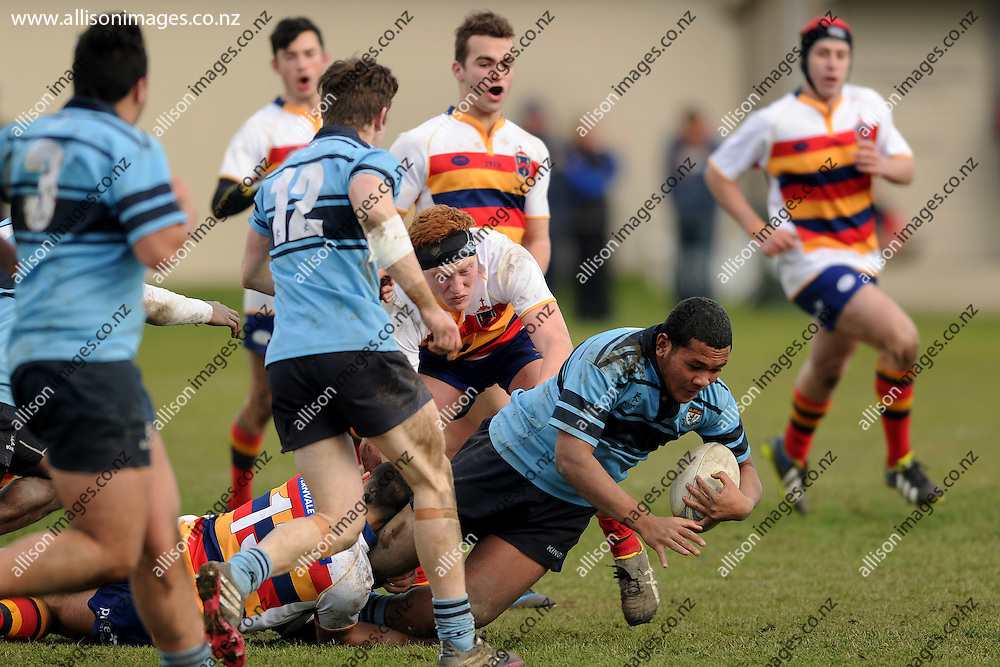 Ta'u Latu of Kings is tackled to the ground, during the ODT Cup match between Kings High School and John McGlashan College, held at Kings High School, Dunedin, New Zealand,  20 June 2015. Credit: Joe Allison / allisonimages.co.nz