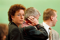 13 MAY 1999 - BIELEFELD, GERMANY:<br /> Angelika Beer, MdB, Verteidigungspolitische Sprecherin der BT-Fraktion, und Joschka Fuscher, Bundesaußenminister, kurz nachdem Fischer von einer Farbbombe getroffen wurde, a.o. Bundesdelegiertenkonferenz von Bündnis 90/Die Grünen, Stadthalle<br /> Angelika Beer, defense politican speaker of the green party in the German Bundestag, and Joschka Fischer, Federal Minister of Foreign Affairs, seconds after Fischer was attacked by a peace protester with a red paint bomb, party congress of the german green party<br /> IMAGE: 19990513-01/03-21<br /> KEYWORDS: Parteitag, Farbe