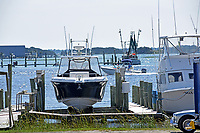 Boats lifted and docked along the marina at Swansboro on the White Oak River.
