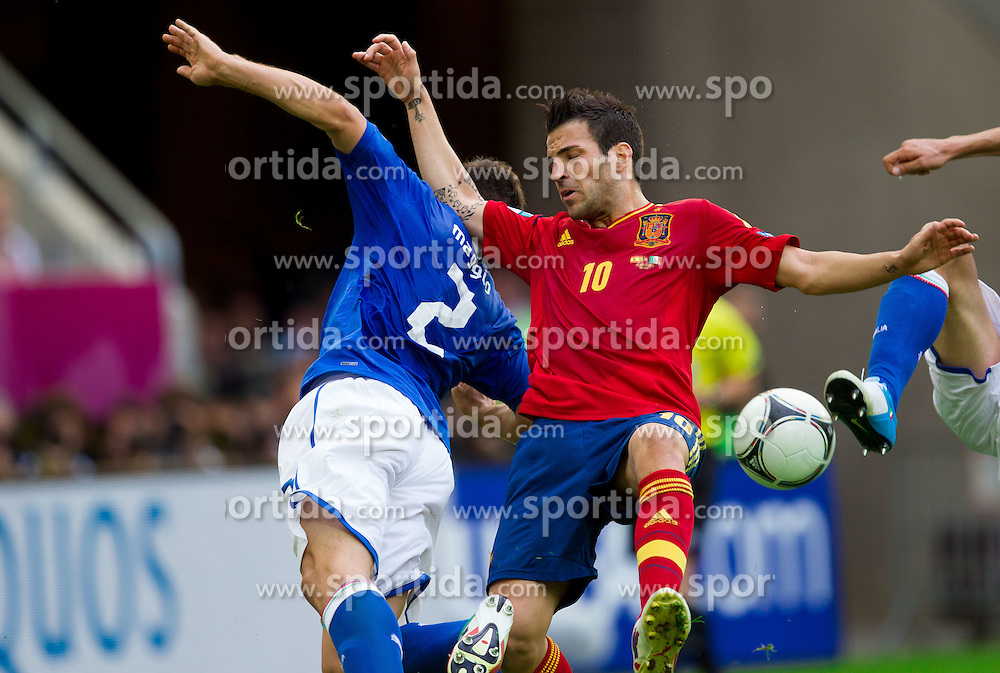 Christian Maggio of Italy vs Cesc Fabregas of Spain during the UEFA EURO 2012 group C match between Spain and Italy at The Arena Gdansk on June 10, 2012 in Gdansk, Poland.  (Photo by Vid Ponikvar / Sportida.com)