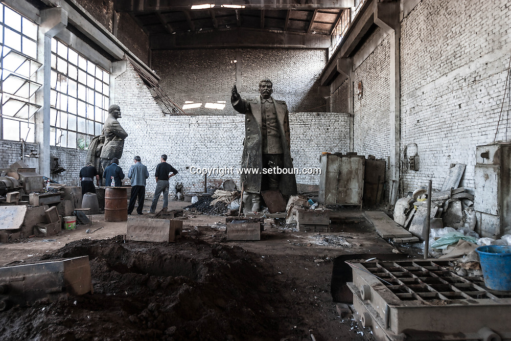 Albania. Tirana. VLADIMIR METANI, ARTIST SCULPTOR , WORKING IN AN OLD FACTORY WITH STATUES OF LENINE , STALINE AND ENVER HOXHA  Tirana  Albania   / le sculpteur Vladimir Metani dans son atelier ou sont remisees les statues de Staline, LENINE, HENVER HOXHA  Tirana  Albanie