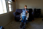 Charlotte Cronin embraces her son, Daniel, as they both struggle with his symptoms of autism. ©Peoria Journal Star/David Zalaznik