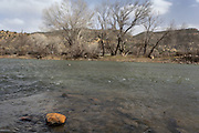 CREDIT: Steven St. John for The Wall Street Journal<br /> &quot;ANIMAS&quot;<br /> <br /> A discolored rock sits above the water line in the Animas River on Tuesday, March 22, 2016. Six months after an EPA crew triggered a toxic spill at a Colorado gold mine, state and local officials downstream are scrambling to prepare for a new emergency as spring snow melt threatens to stir up lead and other contaminants in a river used for drinking water.