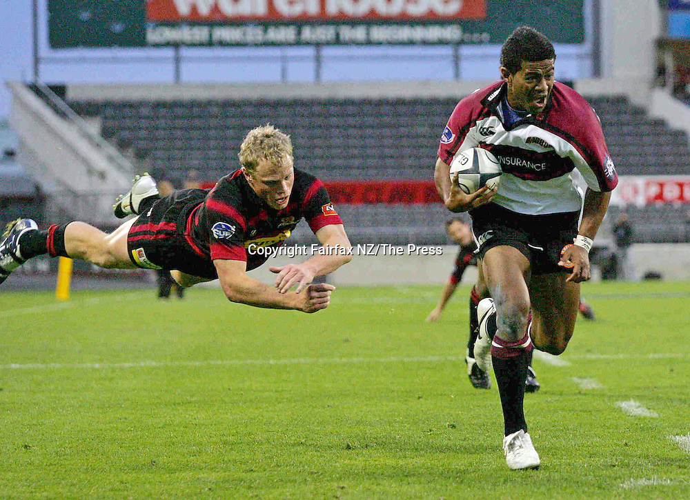 North Harbour wing Vili Waqaseduadua leaves his opposite Scott Hamilton grasping thin air as he goes past him to score the winning try in the Ranfurly Shield match played at Jade Stadium in Christchurch on Sunday. North Harbour won the shield from Canterbury, beating them 21-17 for the first time in the history of the province, and after failing in 10 previous attempts.