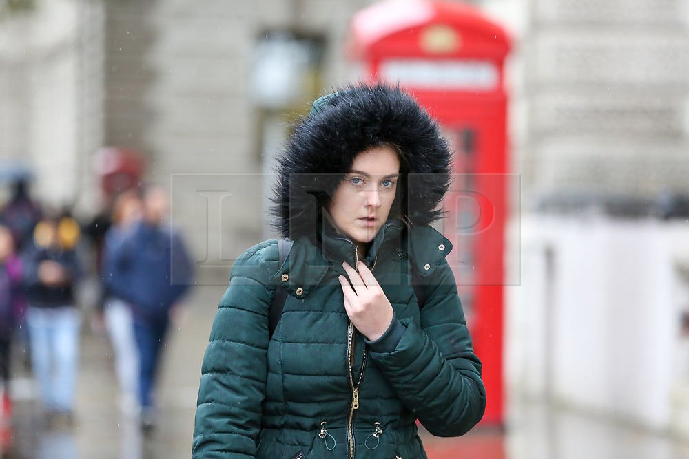 © Licensed to London News Pictures. 21/10/2019. London, UK. A woman covers her head during rain and cold weather in Westminster, London. Photo credit: Dinendra Haria/LNP