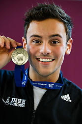 Tom Daley of Dive London Aquatic Centre poses his Gold Medal after winning the Mens 10m Platform Final - Photo mandatory by-line: Rogan Thomson/JMP - 07966 386802 - 22/02/2015 - SPORT - DIVING - Plymouth Life Centre, England - Day 3 - British Gas Diving Championships 2015.