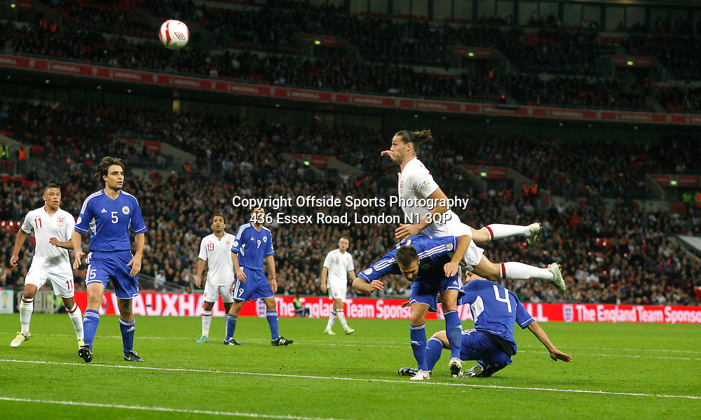 12 October 2012 Football International. England v San Marino.<br /> Andy Carroll gets his head to the ball.