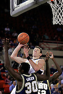 25 November 2005: Marquette Senior forward Steve Novak goes between ORU's Caleb Green (30) and Yemi Ogunoye (52) in the Marquette University 73-70 victory over Oral Roberts University at the Great Alaska Shootout in Anchorage, Alaska