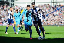 Liam Ridgewell (ENG) of West Brom is challenged by Paulinho (BRA) of Tottenham Hotspur - Photo mandatory by-line: Rogan Thomson/JMP - 07966 386802 - 12/04/2014 - SPORT - FOOTBALL - The Hawthorns Stadium - West Bromwich Albion v Tottenham Hotspur - Barclays Premier League.