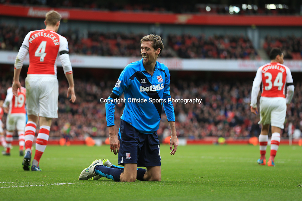 11 January 2015 - Barclays Premier League - Arsenal v Stoke City - Peter Crouch of Stoke City pokes his tongue out after missing a chance - Photo: Marc Atkins / Offside.
