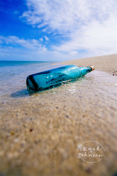 Message in a Bottle washed up on a beach, Great Barrier Reef Marine Park, Australia