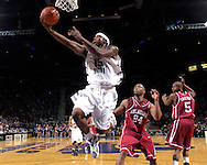 Kansas State forward David Hoskins (15) drives through the lane past Oklahoma defenders Nate Carter (24) and Tony Crocker (5) for the score, during second half action at Bramlage Coliseum in Manhattan, Kansas, March 3, 2007.  K-State beat Oklahoma 72-61.