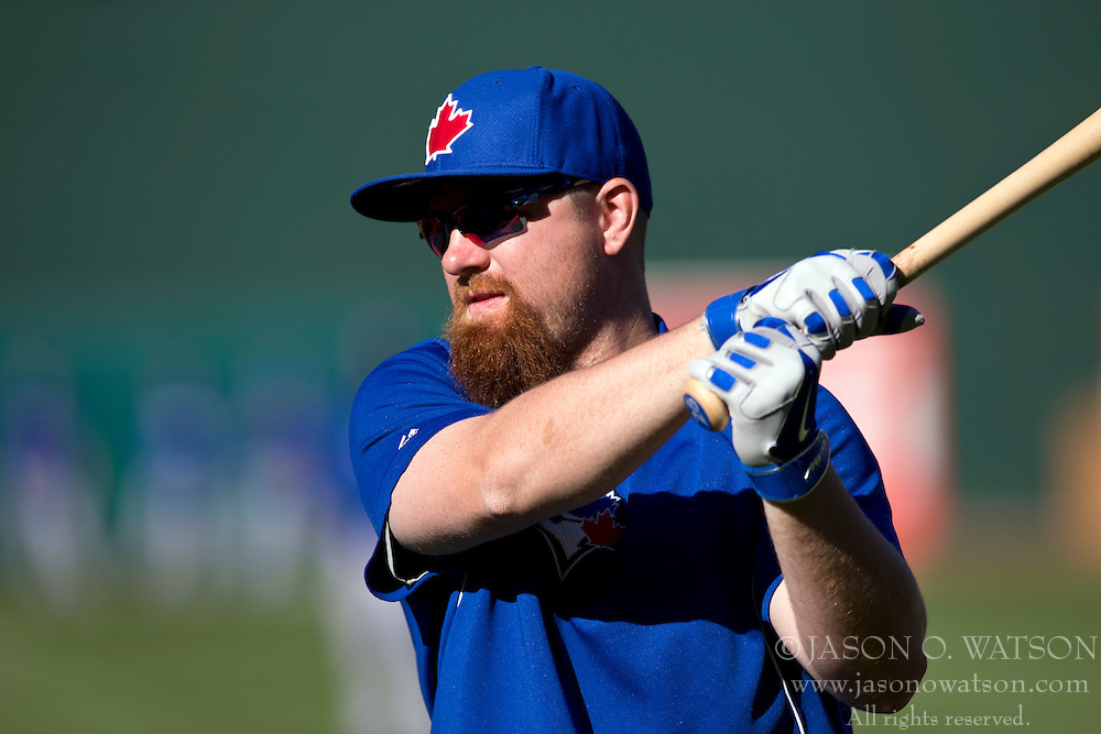 OAKLAND, CA - JULY 05:  Adam Lind #26 of the Toronto Blue Jays swings a bat during batting practice before the game against the Oakland Athletics at O.co Coliseum on July 5, 2014 in Oakland, California. The Oakland Athletics defeated the Toronto Blue Jays 5-1.  (Photo by Jason O. Watson/Getty Images) *** Local Caption *** Adam Lind