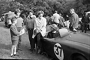 Phoenix Park Motor Race Practice.  Mrs. Joe Flynn and her children turned out at dawn to watch her husband race in an A.C. Bristol during the practise for the Gold Flake Trophy Race..12.07.1962