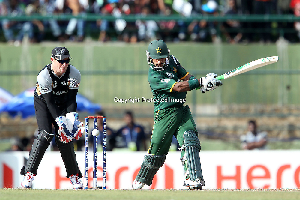 Mohammad Hafeez is clean bowled by James Franklin during the ICC World Twenty20 Pool match between Pakistan and New Zealand held at the  Pallekele Stadium in Kandy, Sri Lanka on the 23rd September 2012<br /> <br /> Photo by Ron Gaunt/SPORTZPICS/PHOTOSPORT