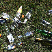 Empty bottles on the grassed spectator area during a day at the Races at Ascot Park, Invercargill, Southland, New Zealand. 10th December 2011. Photo Tim Clayton