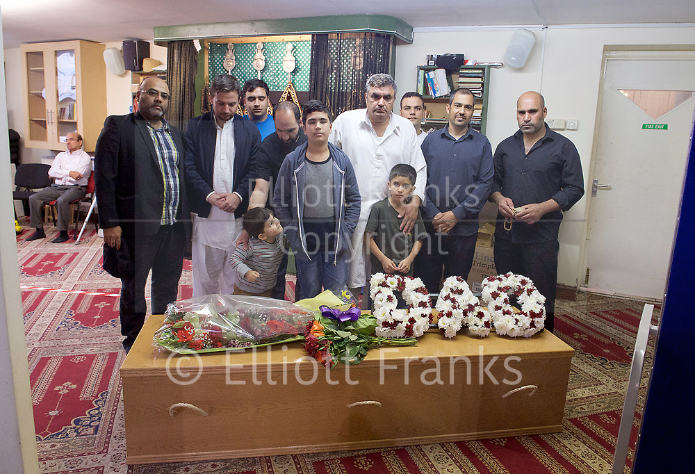 Ali Jafari's funeral prayers  <br /> Mr Ali Jafari, aged 82,  died following the fire at Grenfell Tower,<br /> 14th July 2017 <br /> <br /> Prayers at the Hussaini Islamic Mission, Thornbury Road, Isleworth, <br /> <br /> The cortege departing  from the Hussaina Islamic Mission <br /> <br /> Mr Jafari's three sons and family around the coffin which was placed at the back of the mosque <br /> <br /> Bashir Jafari <br /> <br /> Hamid Jafari <br /> <br /> Farid Jafari <br /> <br /> <br /> Photograph by Elliott Franks <br /> Image licensed to Elliott Franks Photography Services