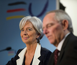 Christine Lagarde, France's finance minister, left, listens as Wolfgang Schaeuble, Germany's finance minister, speaks, during a joint press conference following the first meeting of the Van Rompuy task force on economic governance, in Brussels, Belgium, on Friday, May 21, 2010.  (Photo © Jock Fistick)