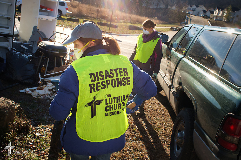 Erica Schwan of LCMS Communications works with other volunteers from the International Center of The Lutheran Church–Missouri Synod, LCMS Disaster Response, New Beginnings Lutheran Church in Pacific, Mo., and Missouri representatives of the Southern Baptist Convention Disaster Relief, during a cleaning event at a flooded home in Fenton on Thursday, Jan. 14, 2016. LCMS Communications/Erik M. Lunsford